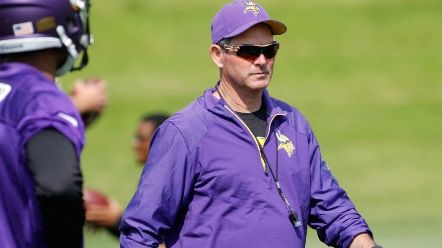 <p>Minnesota Vikings head coach Mike Zimmer walks across the field during NFL football minicamp in Eden Prairie, Minn., Wednesday, June 17, 2015. (AP Photo/Ann Heisenfelt)</p>