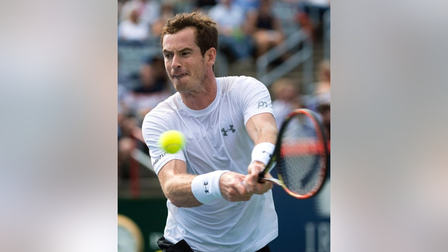Andy Murray, of Britain, returns to Gilles Muller, of Luxembourg, at the Rogers Cup tennis tournament Thursday. Aug. 13, 2015, in Montreal. Murray won 6-3, 6-2. (Paul Chiasson/The Canadian Press via AP)
