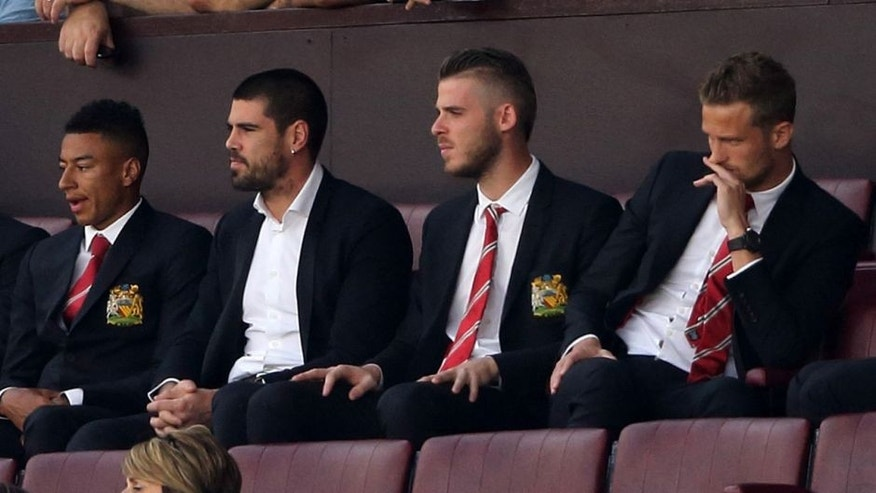 MANCHESTER, ENGLAND - AUGUST 08: Goalkeepers Victor Valdes and David De Gea of Manchester United watch the game from the stands during the Barclays Premier League match between Manchester United and Tottenham Hotspur at Old Trafford on August 08, 2015 in Manchester, England. (Photo by Matthew Ashton - AMA/Getty Images)
