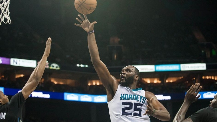 Jan 19, 2015; Charlotte, NC, USA; Charlotte Hornets center Al Jefferson (25) shoots the ball during the second half against the Minnesota Timberwolves at Time Warner Cable Arena. The Hornets won 105-80. Mandatory Credit: Jeremy Brevard-USA TODAY Sports