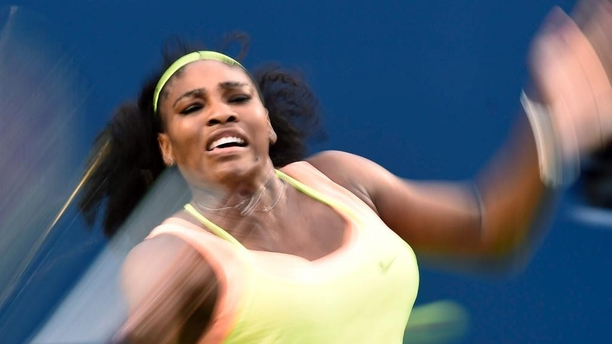 Serena Williams, of the United States, returns to Roberta Vinci, of Italy during the quarter-finals at the Rogers Cup tennis tournament, Friday, Aug. 14, 2015 in Toronto. (Frank Gunn/The Canadian Press via AP) MANDATORY CREDIT