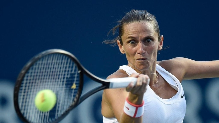 Roberta Vinci, of Italy, returns to Serena Williams, of the United States during the quarter-finals at the Rogers Cup tennis tournament, Friday, Aug. 14, 2015 in Toronto. (Frank Gunn/The Canadian Press via AP) MANDATORY CREDIT