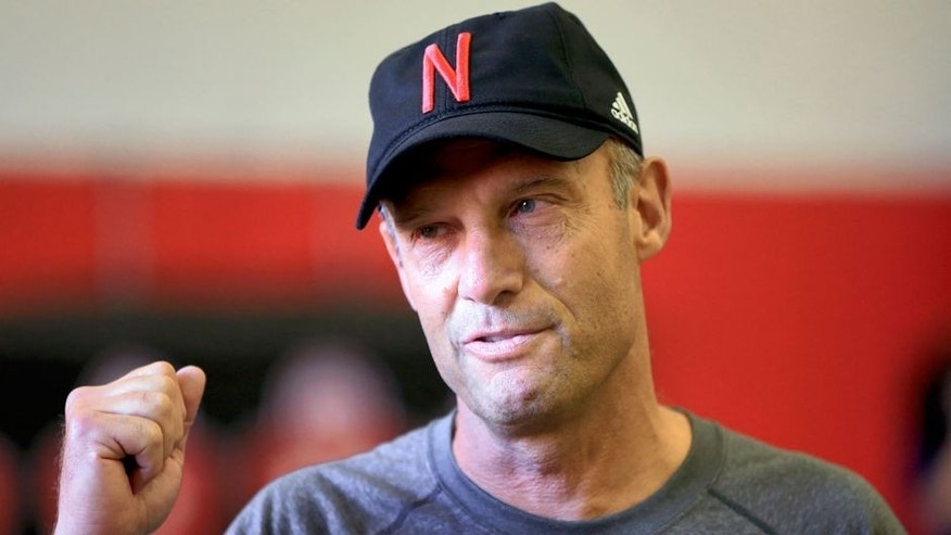 Nebraska head coach Mike Riley talks with people on the sidelines before an NCAA college football practice, Tuesday, Aug. 11, 2015, in Lincoln, Neb. (AP Photo/Nati Harnik)