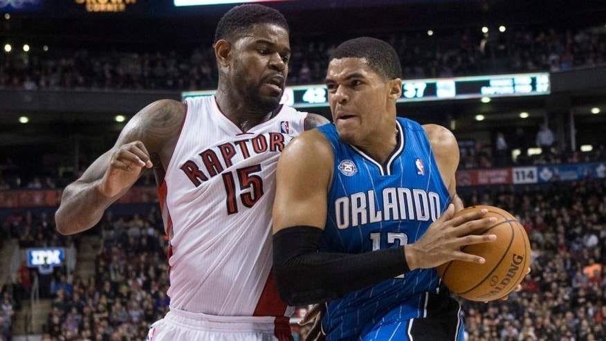 <p>Orlando Magic's Tobias Harris, right, drives at Toronto Raptors' Amir Johnson during the first half of an NBA basketball game in Toronto, Sunday, Feb. 23, 2014. (AP Photo/The Canadian Press, Chris Young)</p>