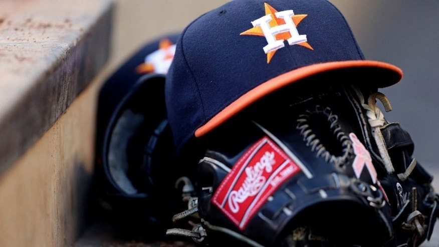 Aug 2, 2013; Minneapolis, MN, USA; A general view of a Houston Astros hat and glove in the dugout during a game against the Minnesota Twins at Target Field. Mandatory Credit: Jesse Johnson-USA TODAY Sports