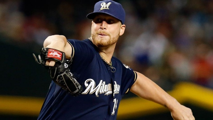 <p>Jul 24, 2015; Phoenix, AZ, USA; Milwaukee Brewers relief pitcher Will Smith (13) throws in the eighth inning against the Arizona Diamondbacks at Chase Field. Mandatory Credit: Rick Scuteri-USA TODAY Sports</p>