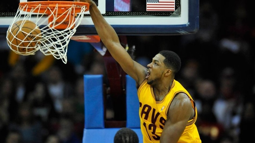 Mar 18, 2014; Cleveland, OH, USA; Cleveland Cavaliers forward Tristan Thompson (13) dunks against the Miami Heat in the first quarter at Quicken Loans Arena. Mandatory Credit: David Richard-USA TODAY Sports