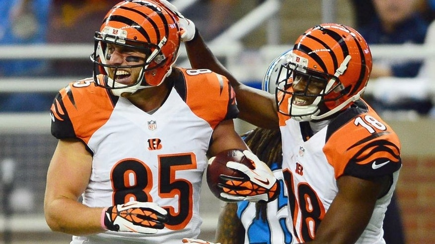 Oct 20, 2013; Detroit, MI, USA; Cincinnati Bengals wide receiver A.J. Green (18) congratulates tight end Tyler Eifert (85) after catching a pass for a touchdown during the third quarter against the Detroit Lions at Ford Field. Mandatory Credit: Andrew Weber-USA TODAY Sports