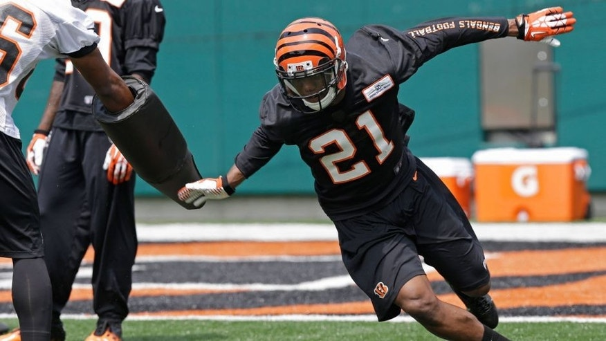 Cincinnati Bengals first round draft pick Darqueze Dennard, a cornerback from Michigan State, runs a drill during an NFL football organized team activity, Tuesday, May 27, 2014, in Cincinnati. (AP Photo/Al Behrman)