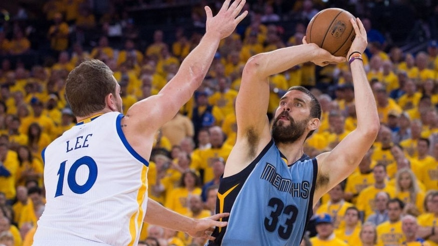 May 13, 2015; Oakland, CA, USA; Memphis Grizzlies center Marc Gasol (33) shoots the basketball against Golden State Warriors forward David Lee (10) during the fourth quarter in game five of the second round of the NBA Playoffs at Oracle Arena. The Warriors defeated the Grizzlies 98-78. Mandatory Credit: Kyle Terada-USA TODAY Sports