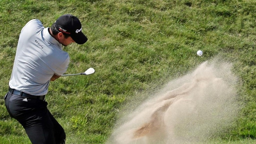 Jason Day, of Australia, hits out of a bunker on the sixth hole during the second round of the PGA Championship golf tournament Friday, Aug. 14, 2015, at Whistling Straits in Haven, Wis. (AP Photo/Jae Hong)