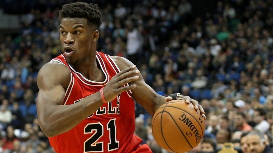 <p>Nov 1, 2014; Minneapolis, MN, USA; Chicago Bulls guard Jimmy Butler (21) dribbles during the first quarter against the Minnesota Timberwolves at Target Center. Mandatory Credit: Brace Hemmelgarn-USA TODAY Sports</p>