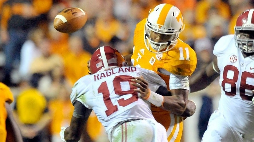 Oct 25, 2014; Knoxville, TN, USA; Tennessee Volunteers quarterback Joshua Dobbs (11) fumbles the ball as he is hit by Alabama Crimson Tide linebacker Reggie Ragland (19) during the first half game at Neyland Stadium. Mandatory Credit: Jim Brown-USA TODAY Sports