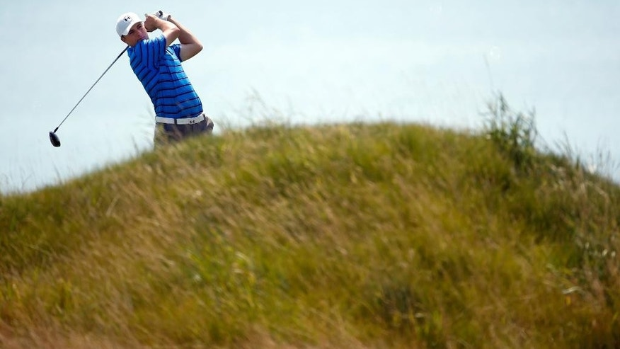 Jordan Spieth hits a drive on the fifth hole during the second round of the PGA Championship golf tournament Friday, Aug. 14, 2015, at Whistling Straits in Haven, Wis. (AP Photo/Julio Cortez)