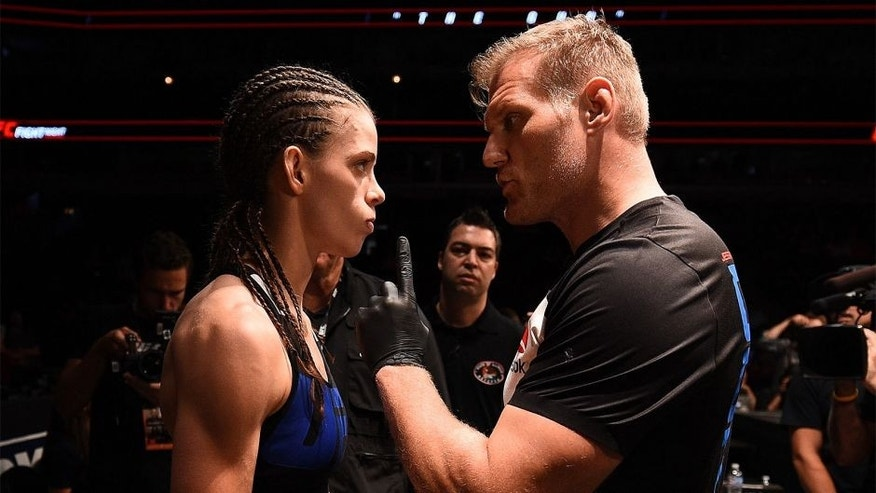 CHICAGO, IL - JULY 25: Jessamyn Duke (L) receives instructions from coach Josh Barnett before her women's bantamweight bout against Elizabeth Phillips during the UFC event at the United Center on July 25, 2015 in Chicago, Illinois. (Photo by Jeff Bottari/Zuffa LLC/Zuffa LLC via Getty Images)