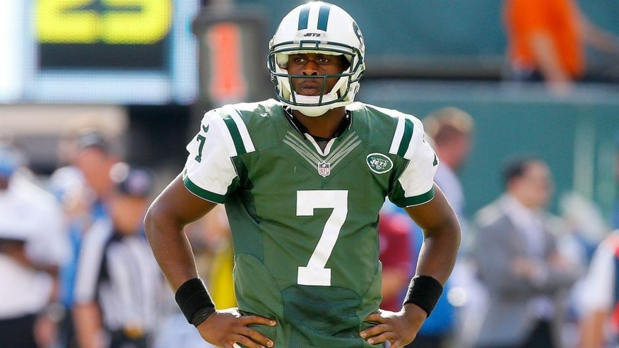 EAST RUTHERFORD, NJ - SEPTEMBER 28: (NEW YORK DAILIES OUT) Geno Smith #7 of the New York Jets in action against the Detroit Lions on September 28, 2014 at MetLife Stadium in East Rutherford, New Jersey. The Lions defeated the Jets 24-17. (Photo by Jim McIsaac/Getty Images)