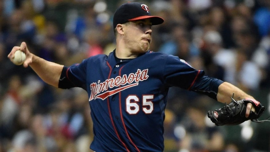 <p>Jun 26, 2015; Milwaukee, WI, USA; Minnesota Twins pitcher Trevor May (65) pitches in the first inning against the Milwaukee Brewers at Miller Park. Mandatory Credit: Benny Sieu-USA TODAY Sports</p>