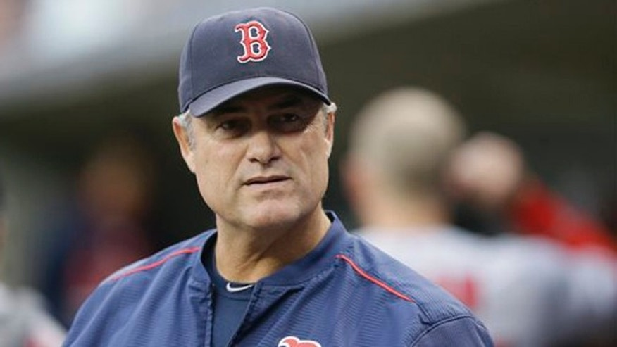 Aug. 8, 2015: In this photo, Boston Red Sox manager John Farrell watches from the dugout during the first inning of a baseball game against the Detroit Tigers in Detroit.