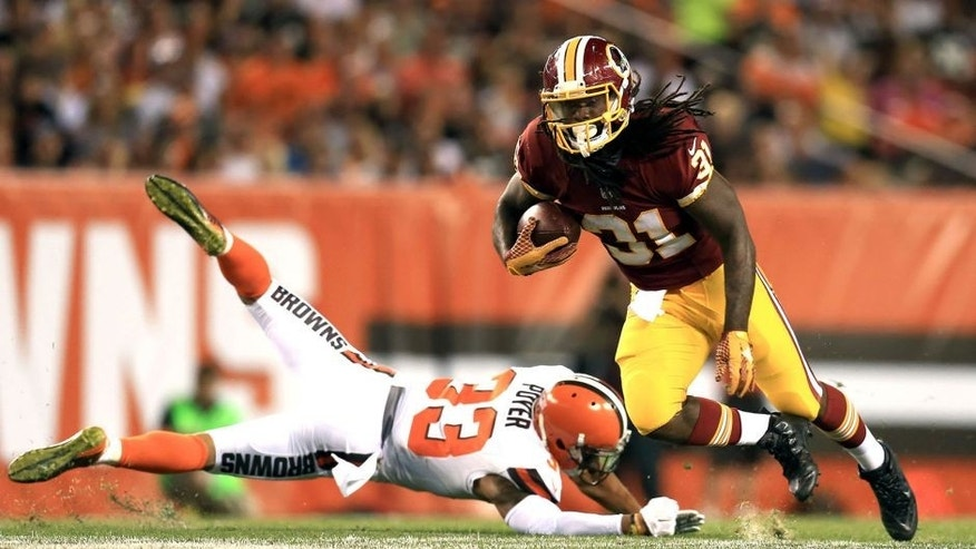 Aug 13, 2015; Cleveland, OH, USA; Washington Redskins running back Matt Jones (31) runs the ball getting away from Cleveland Browns cornerback Jordan Poyer (33) during the second quarter of preseason NFL football game at FirstEnergy Stadium. Mandatory Credit: Andrew Weber-USA TODAY Sports