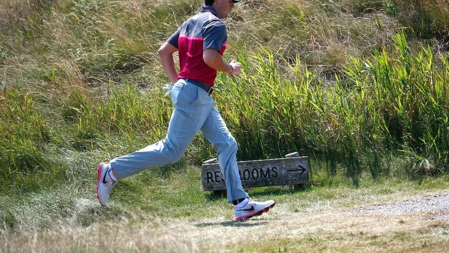 Rory McIlroy, of Northern Ireland, runs to his ball on the fifth hole during the second round of the PGA Championship golf tournament Friday, Aug. 14, 2015, at Whistling Straits in Haven, Wis. (AP Photo/Julio Cortez)