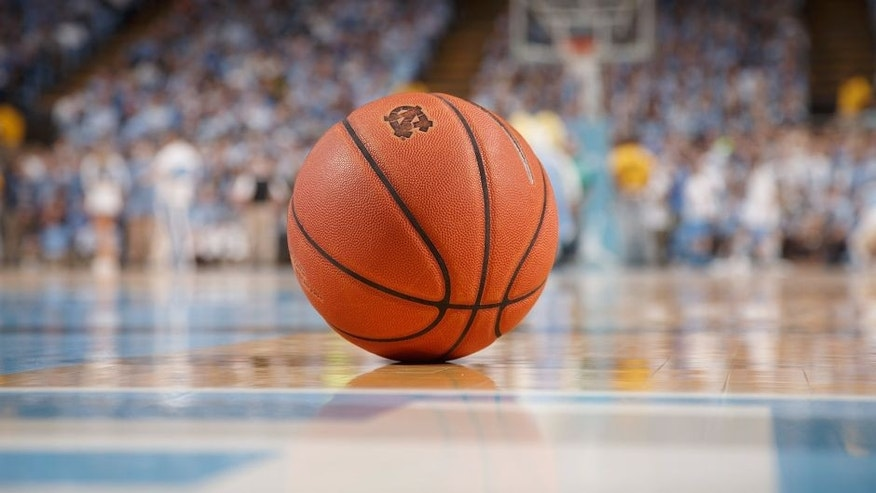 CHAPEL HILL, NC - JANUARY 26: A general view of a basketball with the logo of the North Carolina Tar Heels sitting on the court during a timeout against the Syracuse Orange on January 26, 2015 at the Dean E. Smith Center in Chapel Hill, North Carolina. North Carolina won 93-83. (Photo by Peyton Williams/UNC/Getty Images)