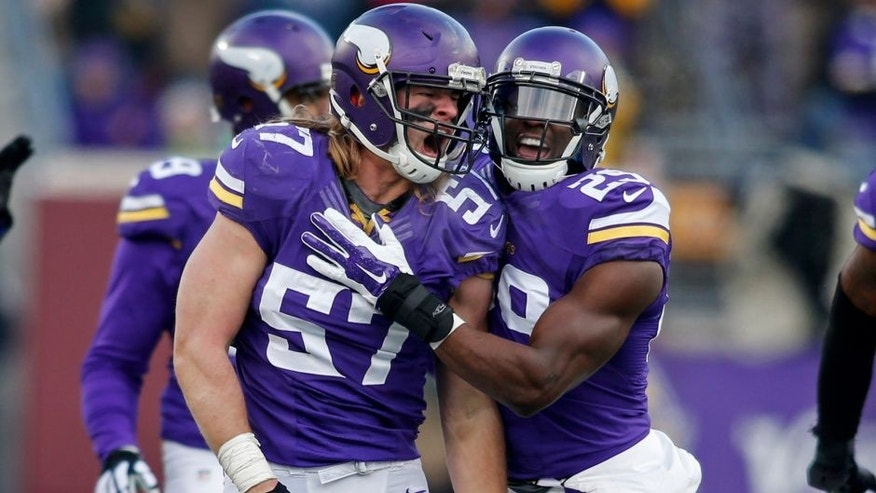 <p>Dec 28, 2014; Minneapolis, MN, USA; Minnesota Vikings linebacker Audie Cole (57) celebrates his defensive play against the Chicago Bears with Xavier Rhodes in the fourth quarter at TCF Bank Stadium. The Vikings win 13-9. Mandatory Credit: Bruce Kluckhohn-USA TODAY Sports</p>