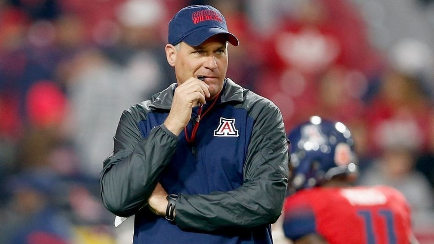 GLENDALE, AZ - DECEMBER 31: Head coach Rich Rodriguez of the Arizona Wildcats watches warm ups before the Vizio Fiesta Bowl against the Boise State Broncos at University of Phoenix Stadium on December 31, 2014 in Glendale, Arizona. (Photo by Christian Petersen/Getty Images)