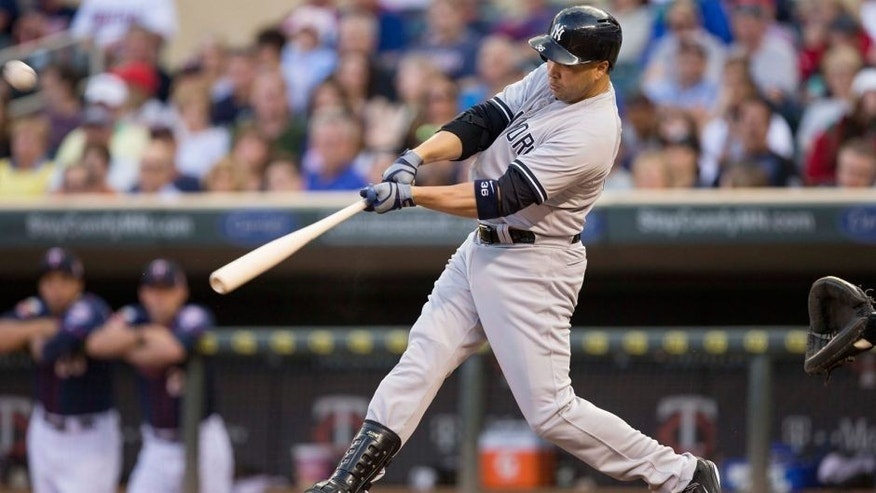 <p>Jul 3, 2014; Minneapolis, MN, USA; New York Yankees designated hitter Carlos Beltran (36) hits a three run home run in the fifth inning against the Minnesota Twins at Target Field. Mandatory Credit: Jesse Johnson-USA TODAY Sports</p>