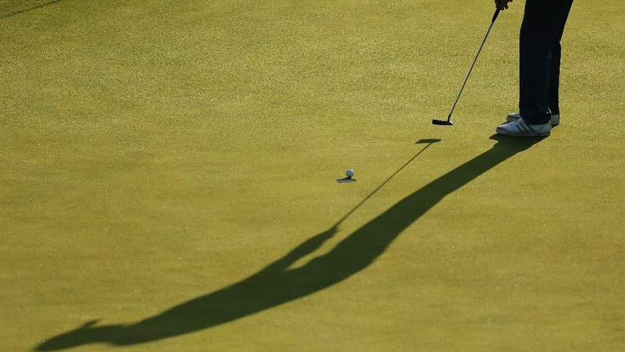 Justin Rose, of England, makes his par put on the 18th hole during the second round of the PGA Championship golf tournament Saturday, Aug. 15, 2015, at Whistling Straits in Haven, Wis. (AP Photo/Chris Carlson)