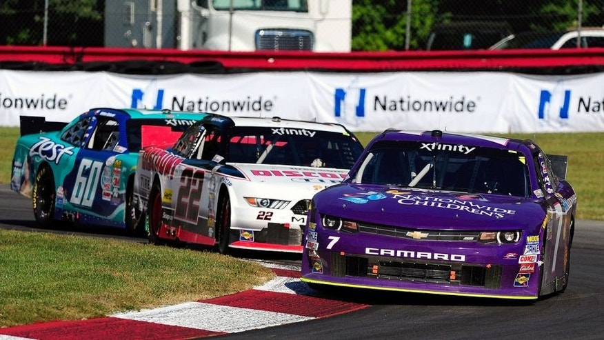LEXINGTON, OH - AUGUST 15: Regan Smith, driver of the #7 Nationwide Children's Hospital Chevrolet, Alex Tagliani, driver of the #22 Discount Tire Ford, and Chris Buescher driver of the #60 Zest Ford, drive during the NASCAR XFINITY Series Nationwide Children's Hospital 200 at Mid-Ohio Sports Car Course on August 15, 2015 in Lexington, Ohio. (Photo by Jeff Curry/Getty Images)