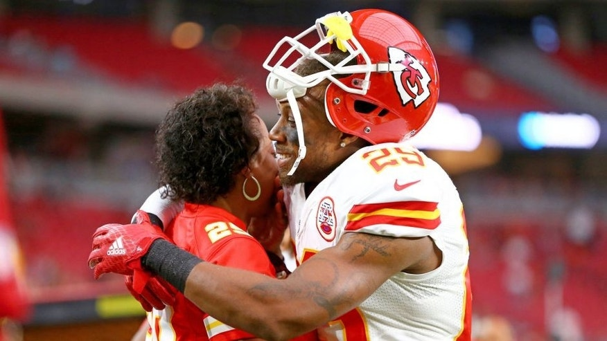 Aug 15, 2015; Glendale, AZ, USA; Kansas City Chiefs defensive back Eric Berry (29) hugs his mother Carol Berry prior to the game against the Arizona Cardinals in a preseason NFL football game at University of Phoenix Stadium. Mandatory Credit: Mark J. Rebilas-USA TODAY Sports