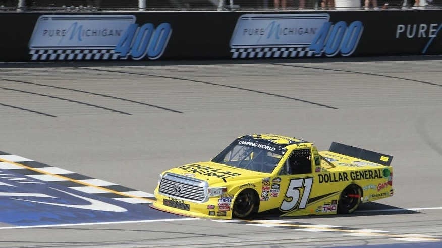 CORRECTS PHOTOGRAPHER'S BYLINE TO BOB BRODBECK INSTEAD OF DAVE FRECHETTE -  Kyle Busch crosses the finish line to win the NASCAR Truck series Careers for Veterans 200 race at Michigan International Speedway, Saturday, Aug. 15, 2015, in Brooklyn, Mich. (AP Photo/Bob Brodbeck)
