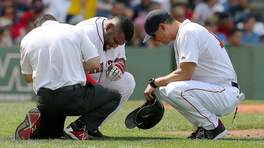 BOSTON, MA - AUGUST 15: Torey Lovullo #17 of the Boston Red Sox and trainer attend to Pablo Sandoval #48 who was hit by a pitch in the third inning at Fenway Park on August 15, 2015 in Boston, Massachusetts. (Photo by Jim Rogash/Getty Images)