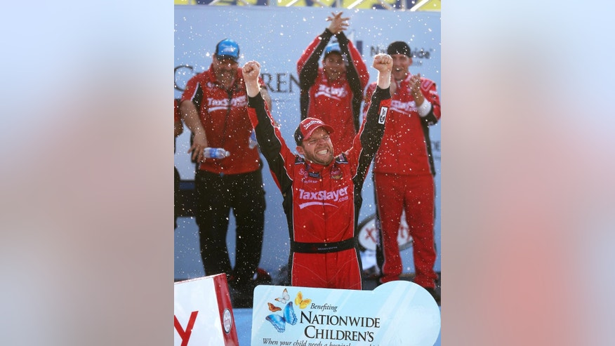 Regan Smith celebrates after winning the NASCAR Xfinity Series auto race at Mid-Ohio Sports Car Course on Saturday, Aug. 15, 2015, in Lexington, Ohio. (AP Photo/Tom E. Puskar)
