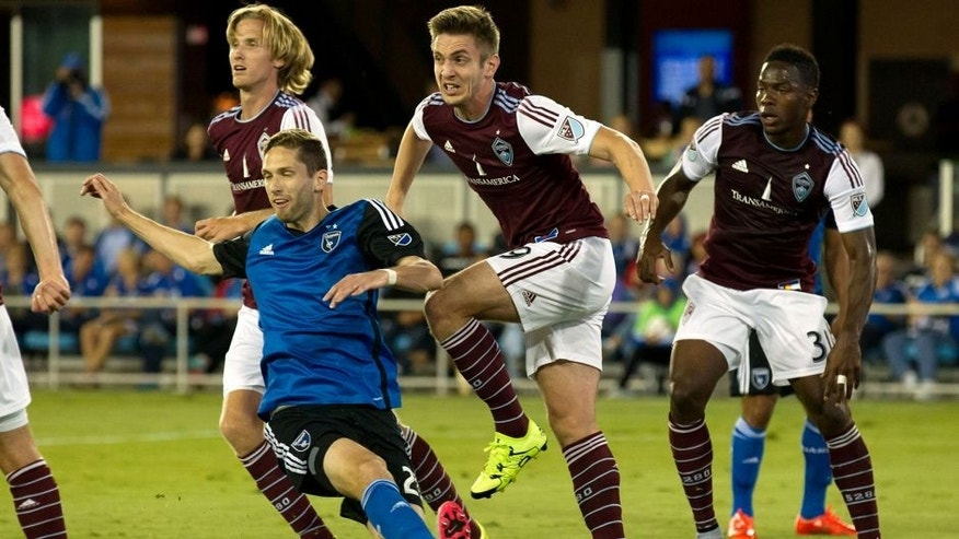 Aug 14, 2015; San Jose, CA, USA; Colorado Rapids forward Kevin Doyle (9) kicks out the ball against San Jose Earthquakes defender Clarence Goodson (21) during the first half at Avaya Stadium. Mandatory Credit: Kelley L Cox-USA TODAY Sports