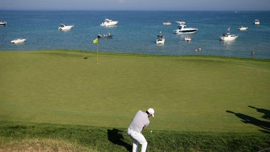 Jason Day, of Australia, hits on the seventh hole during the third round of the PGA Championship golf tournament Saturday, Aug. 15, 2015, at Whistling Straits in Haven, Wis. (AP Photo/Jae Hong)