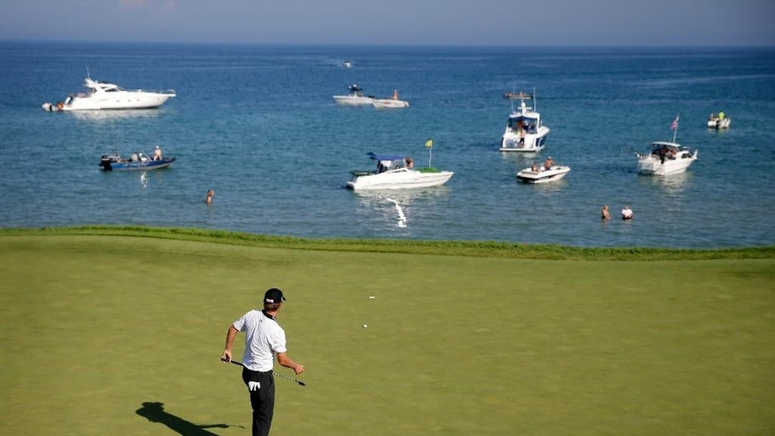 Matt Jones, of Australia, putts on the seventh hole during the third round of the PGA Championship golf tournament Saturday, Aug. 15, 2015, at Whistling Straits in Haven, Wis. (AP Photo/Jae Hong)
