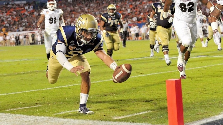 Dec 31, 2014; Miami Gardens, FL, USA; Georgia Tech Yellow Jackets quarterback Justin Thomas (5) dives into the end zone for a touchdown during the second quarter against Mississippi State Bulldogs in the 2014 Orange Bowl at Sun Life Stadium. Mandatory Credit: Steve Mitchell-USA TODAY Sports