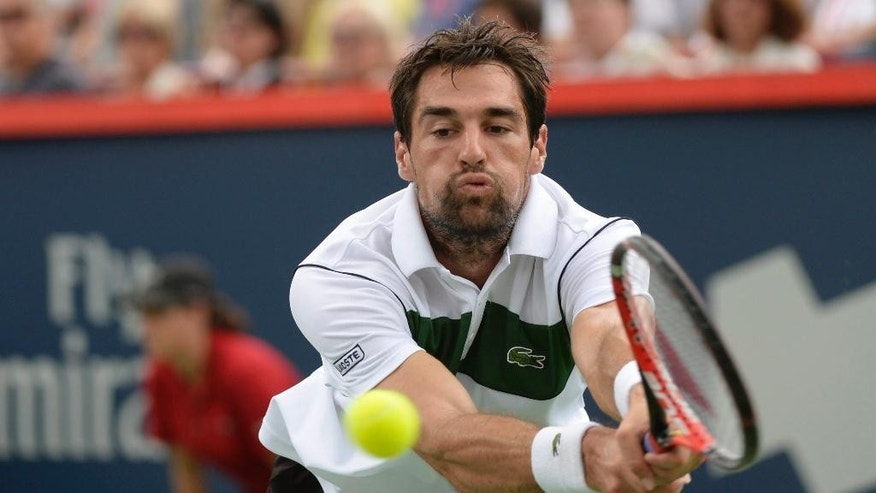 Jeremy Chardy, of France, reaches to return to opponent Novak Djokovic, of Serbia, during the Rogers Cup semifinal tennis tournament, Saturday, Aug. 15, 2015 in Montreal.(Paul Chiasson/The Canadian Press via AP) MANDATORY CREDIT