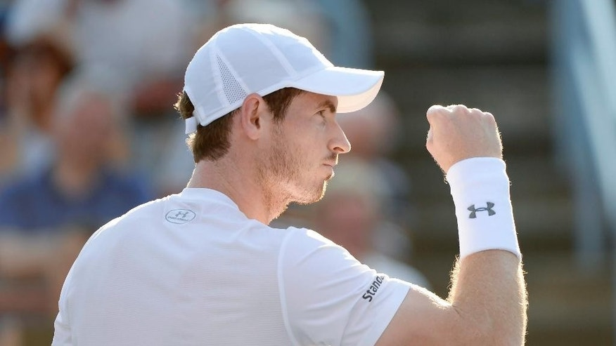 Andy Murray, of Great Britain, reacts during his match against Novak Djokovic in the men's final at the Rogers Cup tennis tournament in Montreal on Sunday, Aug. 16, 2015. (Paul Chiasson/The Canadian Press via AP) MANDATORY CREDIT