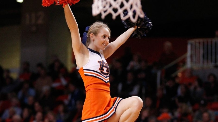 Jan 18, 2014; Auburn, AL, USA; Auburn Cheerleader during the game against the Florida Gators at Auburn Arena. The Gators defeated the Tigers 68-61. Mandatory Credit: Marvin Gentry-USA TODAY Sports