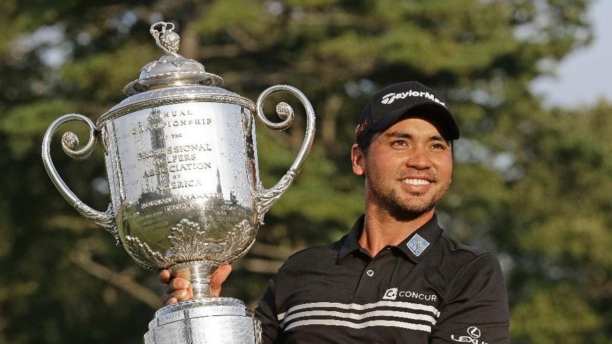 Jason Day, of Australia, holds up the Wanamaker Trophy after winning the PGA Championship golf tournament Sunday, Aug. 16, 2015, at Whistling Straits in Haven, Wis. (AP Photo/Brynn Anderson)