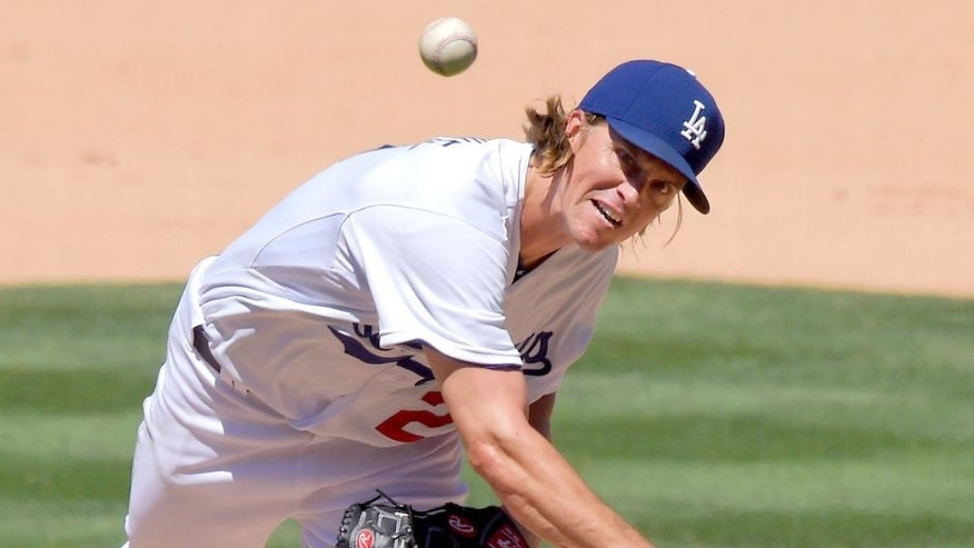 Los Angeles Dodgers starting pitcher Zack Greinke throws to the plate during the fifth inning of a baseball game against the Cincinnati Reds, Sunday, Aug. 16, 2015, in Los Angeles. (AP Photo/Mark J. Terrill)
