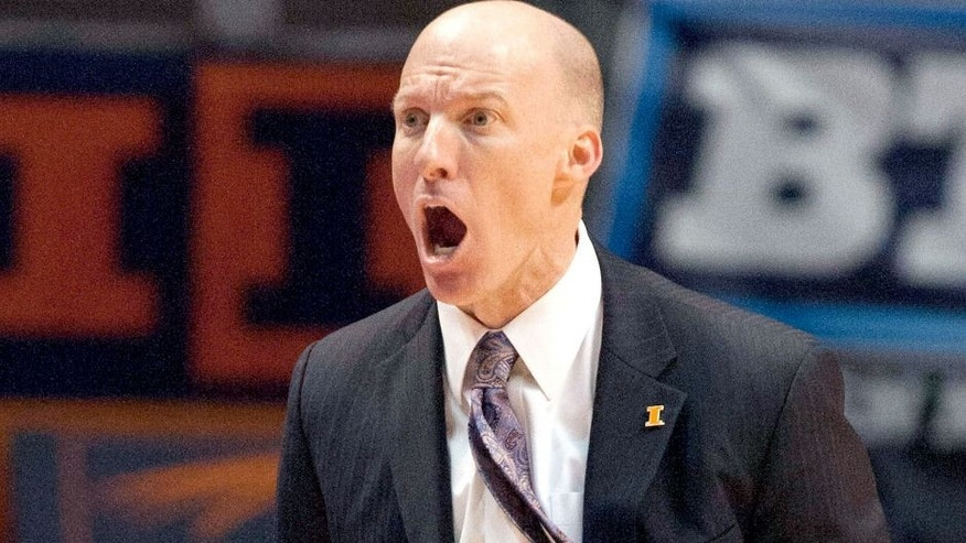 Jan 18, 2014; Champaign, IL, USA; Illinois Fighting Illini head coach John Groce yells at the referees during the game against the Michigan State Spartans at State Farm Center. The Michigan State Spartans beat the Illinois Fighting Illini 78-62. Mandatory Credit: Trevor Ruszkowksi-USA TODAY Sports