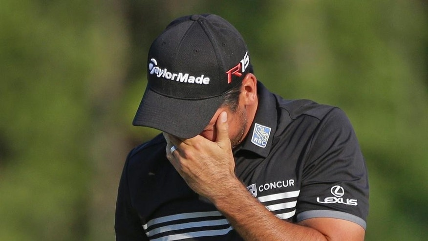 Jason Day, of Australia, cries before his last putt at the PGA Championship golf tournament Sunday, Aug. 16, 2015, at Whistling Straits in Haven, Wis.  (AP Photo/Jae Hong)