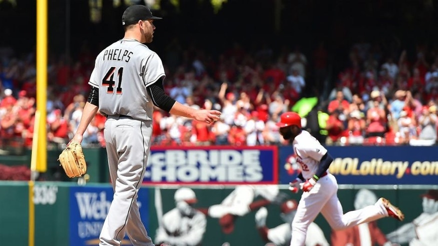 <p>Aug 16, 2015; St. Louis, MO, USA; Miami Marlins starting pitcher David Phelps (41) reacts as St. Louis Cardinals right fielder Jason Heyward (22) rounds the basses after hitting a two-run home run in the second inning at Busch Stadium. Mandatory Credit: Jasen Vinlove-USA TODAY Sports</p>