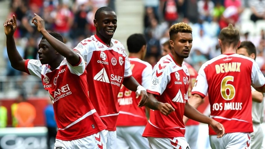 Reims' team celebrates after Reims' Malian defender Hamari Traore scored a goal during the French L1 championship football match Stade de Reims vs Olympique de Marseilles on August 16, 2015 at the Auguste Delaune Stadium in Reims, northern France. AFP PHOTO / PHILIPPE HUGUEN (Photo credit should read PHILIPPE HUGUEN/AFP/Getty Images)