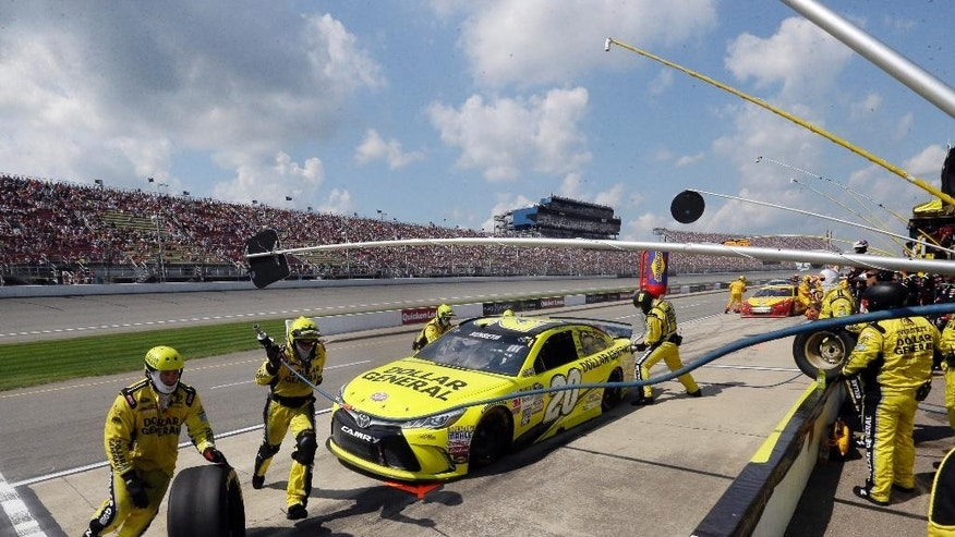 Matt Kenseth makes a pitstop during the NASCAR Sprint Cup series auto race at Michigan International Speedway, Sunday, Aug. 16, 2015, in Brooklyn, Mich. (AP Photo/Carlos Osorio)