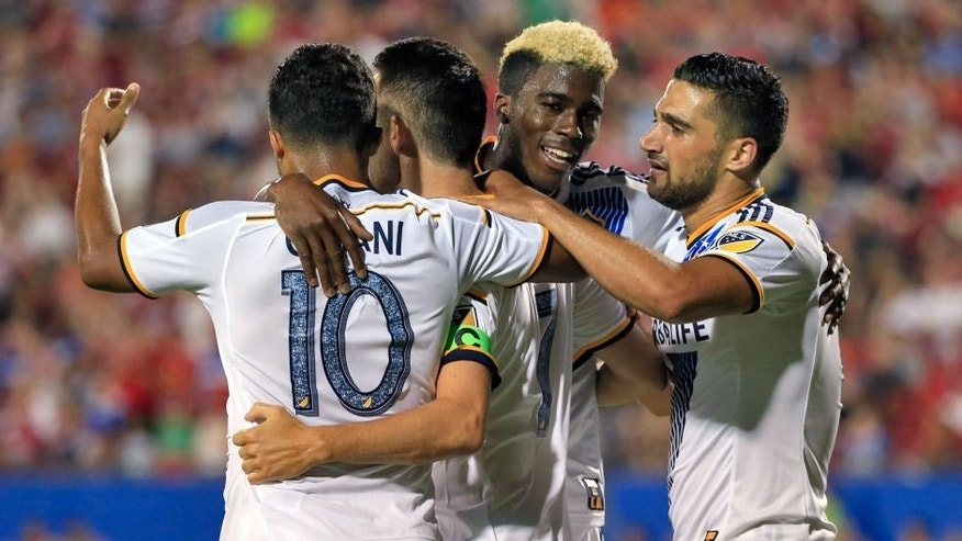 Aug 15, 2015; Dallas, TX, USA; Los Angeles Galaxy forward Robbie Keane (middle) celebrates with teammates after scoring a goal during the second half against FC Dallas at Toyota Stadium. Mandatory Credit: Kevin Jairaj-USA TODAY Sports