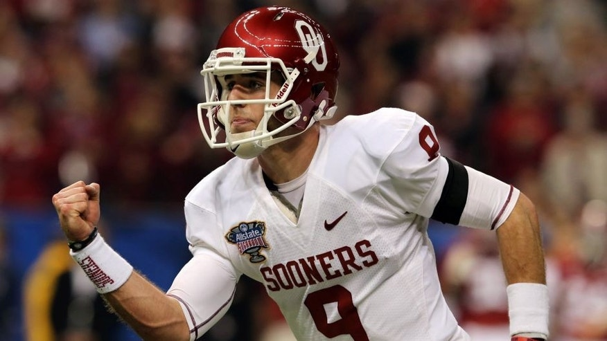 Jan 2, 2014; New Orleans, LA, USA; Oklahoma Sooners quarterback Trevor Knight (9) reacts after throwing a first quarter touchdown pass against the Oklahoma Sooners in the Sugar Bowl at the Mercedes-Benz Superdome. Mandatory Credit: Chuck Cook-USA TODAY Sports